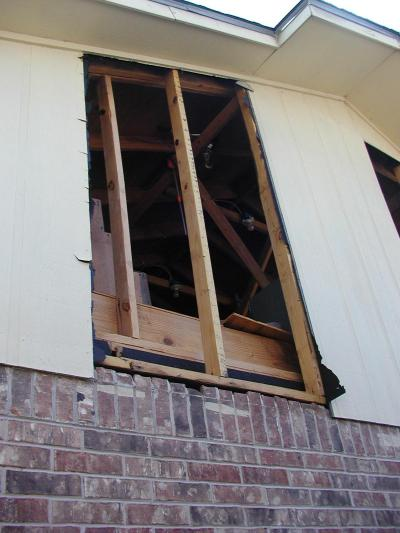 close-up, hole in side of house