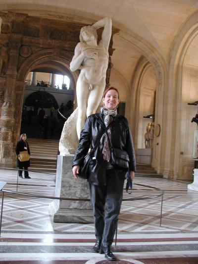 me at the louvre in black and two scarves