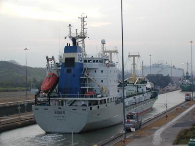 ship being guided through the miraflores locks at the panama canal