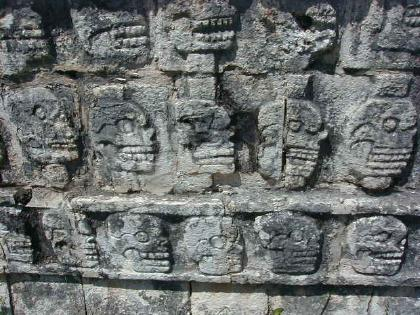 detail of wall of carved skulls seen at Chichen Itza
