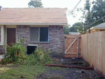 hummingbird garden on the morning of aug 3, 2003, after departure of the roofing and fencing teams
